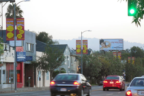 city light pole banner campaign supports cancer charity