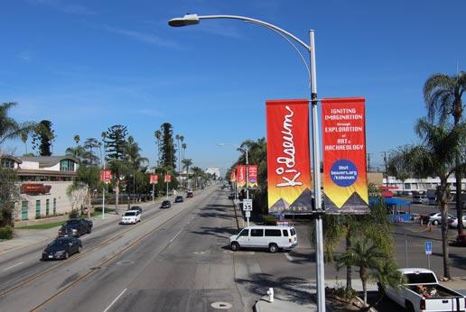 chides light pole banner campaign